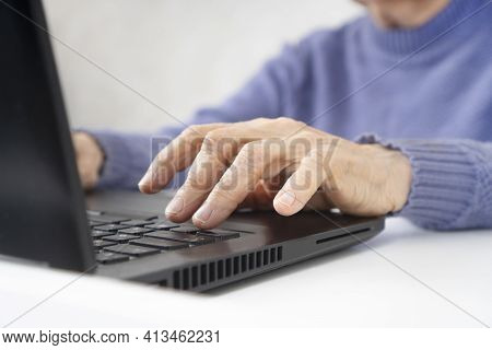 Elderly Woman Wrinkled Hands Typing On A Laptop