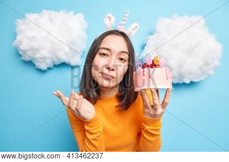 Clueless Hesitant Young Asian Woman Raises Palm Feels Doubt Holds Delicious Cake Celebrates Birthday