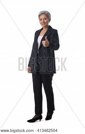 Full Length Portrait Of Happy Beautiful Mature Asian Woman With Thumb Up Isolated On White Backgroun
