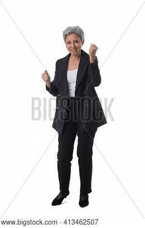 Full Length Portrait Of Happy Beautiful Mature Asian Woman Holding Fists Isolated On White Backgroun