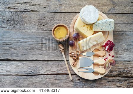 Cheese Board With Camembert Cheese, Parmesan Cheese, Maasdam Cheese. Top View, Copy Space.