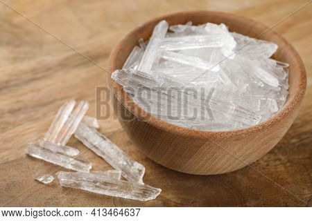 Menthol Crystals In Bowl On Wooden Background