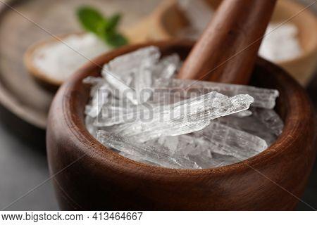 Menthol Crystals In Wooden Mortar, Closeup View