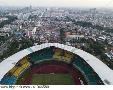 Aerial View Of The Largest Stadium Of Bekasi From Drone When Sunset And Noise Cloud. Bekasi, Indones