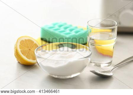 Baking Soda, Lemon And Vinegar On Light Stone Table. Eco Friendly Detergents