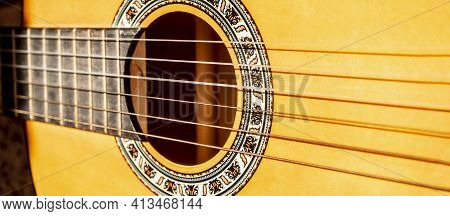 Close-up Of Vibrating Acoustic Guitar Strings. Close Up Shot Of Guitar And Strings With Shallow Dept