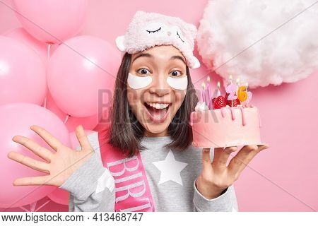 Positive Asian Girl Celebrates Birthday At Home Raises Palm Looks With Excited Expression At Camera