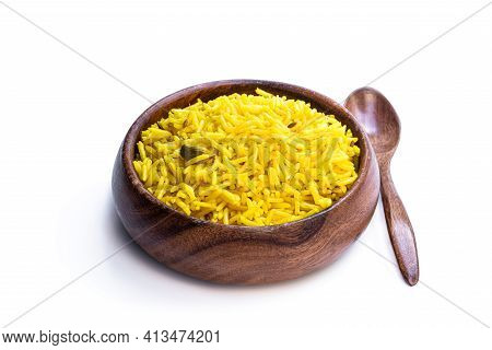 Yellow  Curried Rice In Wooden Bowl Isolated On White