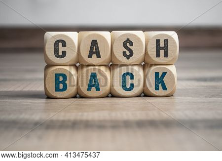 Cubes, Dice Or Blocks With Letters Cashback On Wooden Background
