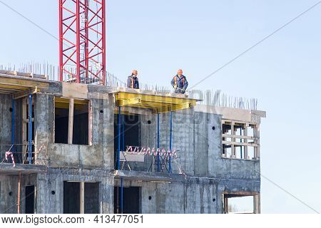 Petrozavodsk, Russia - February 13th, 2019: Builders Are Making A Concrete Screed Between The Floors