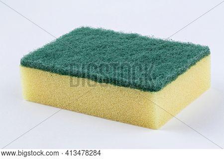 Yellow Kitchen Sponge Against On White Background. Scrub Yellow Sponge Design, Close Up Cleaning Spo