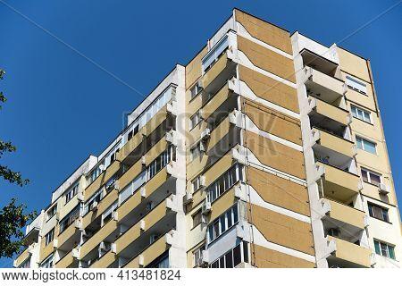 Tall Bulgarian Communist Apartment Block Building On Blue Sky .