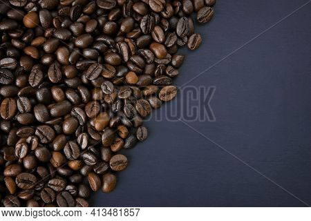 Coffee Cup With Roasted Coffee Beans On A Wooden Table Background With Coffee Beans Scattered On The