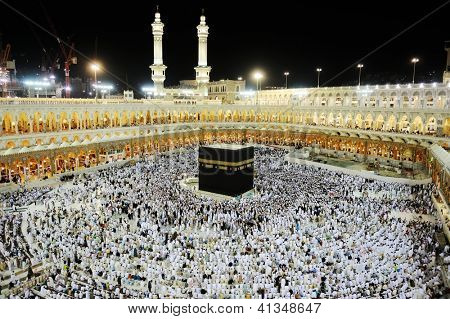 MECCA - JULY 21 : A crowd of pilgrims circumabulate (tawaf) Kaaba on July 21, 2012 in Mecca, Saudi Arabia. Pilgrims circumambulate the Kaaba seven times in counterclockwise direction.