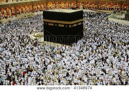 MECCA - JULY 21 : A crowd of pilgrims circumabulate (tawaf) Kaaba on July 21, 2012 in Mecca, Saudi Arabia. Pilgrims circumambulate the Kaaba seven times in counterclockwise direction.