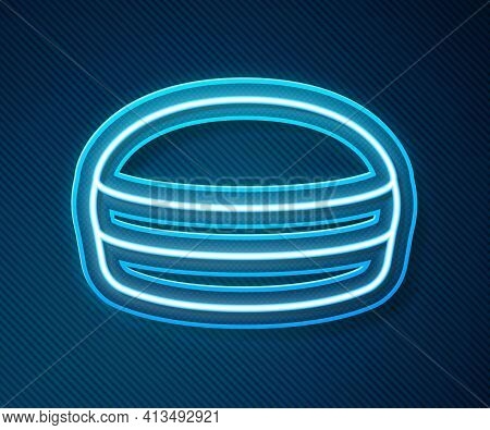 Glowing Neon Line Macaron Cookie Icon Isolated On Blue Background. Macaroon Sweet Bakery. Vector