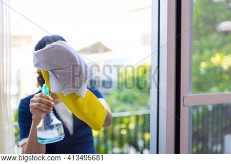 Cleaning Window Pane With Detergent, Maid Cleaning Windows