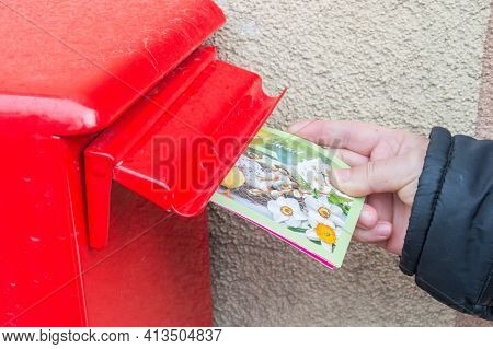 Pruszcz Gdanski, Poland - March 21, 2021: Putting Easter Cards In The Mailbox. Sending Cards For Eas