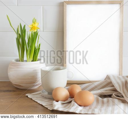 Spring, Easter Breakfast Still Life. A Cup Of Milk, Narcissus, Daffodil Flowers, Hen Eggs, And Empty