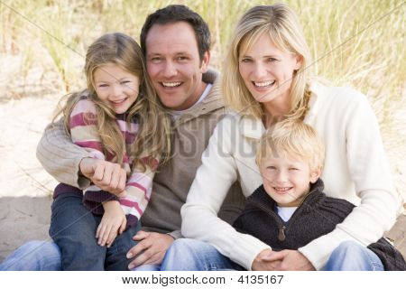 Families Sitting On Beach Smiling