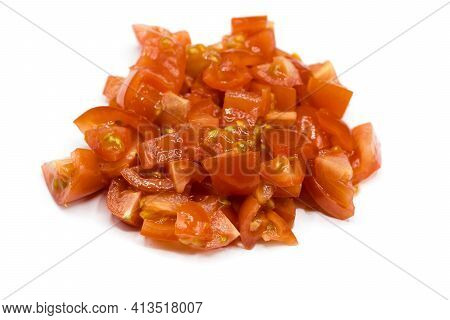Pieces Of Tomato Cubes Isolated On White Background