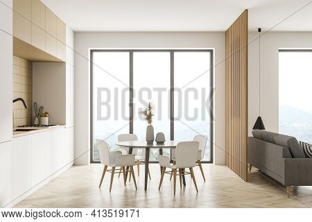 Modern Kitchen Interior, Dining Area And Living Room Space With Panoramic Windows With Countryside A
