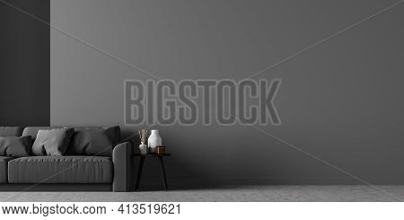 Large And Cosy Living Room Interior With Black Comfortable Sofa And Empty Grey Wall. Concrete Floor.