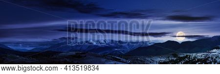 Mountainous Rural Panorama Landscape In Springtime At Night. Beautiful Scenery Beneath A Sky With Cl