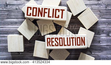 Conflict Resolution, The Phrase Is Written On Wooden Blocks And Brown Background