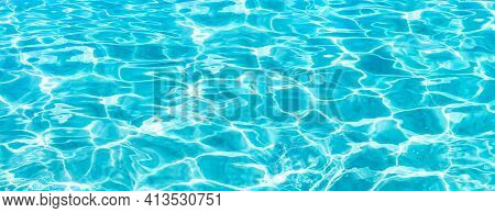 Shining Blue Water Ripple Background. Surface Of Water In Swimming Pool. Tropical Beach Water Backgr