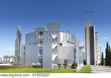 GARDEN GROVE, CALIFORNIA - 20 MAR 2021: Cultural Center at the Crystal Cathedral flanked by the Bell Tower and Tower of Hope.