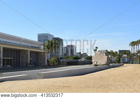 LOS ANGELES - NOVEMBER 24, 2017: Levitated Mass art installation at the Los Angeles County Museum of Art. By Michael Heizer it weighs 340 tons with a trench visitors can walk through.