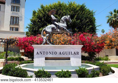 LOS ANGELES, CALIFORNIA - JUNE 12, 2018: The Antonio Aguilar Statue at El Pueblo de Los Angeles Historical Monument, Olvera Street.