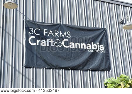 LOS ANGELES, CALIFORNIA - 05 FEB 2020: 3C Farms Craft and Cannabis Cultivation sign, a high-end cannabis cultivator that distributes to its affiliate storefronts.