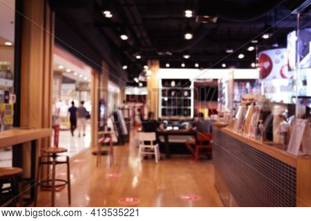 Blurred Cafe Background ,coffee Shop Blur Background With Bokeh Warm Tone.
