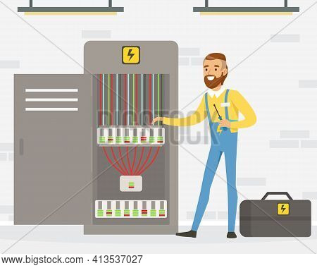 Smiling Man Electrician In Overall Standing Near Switchboard Engaged In Maintenance And Repair Of El