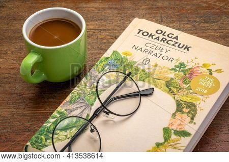 Fort Collins, CO, USA - March 20, 2021: The Tender Narrator (Polish edition), recent book by Olga Tokarczuk with coffee and reading glasses - 2018 Nobel Prize in literature.