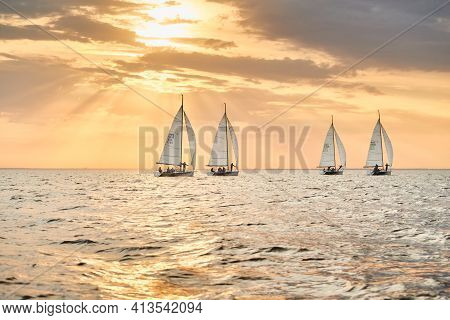 Russia, St.petersburg, 05 September 2020: Some Sailboats In A List Goes By Sea, The Sky Of Pink Colo