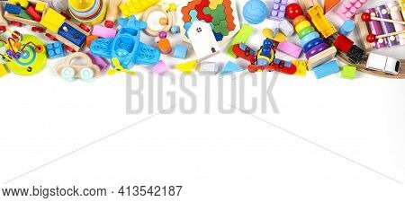 Baby Kids Toy Banner Background. Colorful Educational Toys On White Background. Top View, Flat Lay,