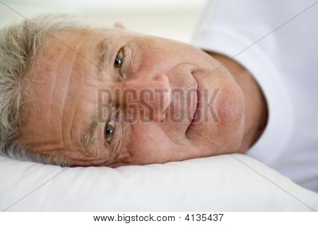 Man Lying In Bed