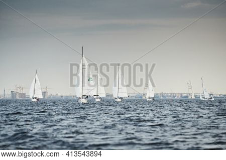 Russia, St.petersburg, 05 September 2020: Some Sailboats In A List Goes By Sea, The Storm Sky, Regat