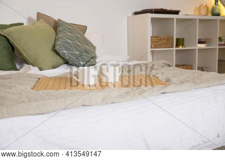 Modern Bedroom With Green Pillows On Bed.comfortable Bed With New Pistachio Cushions, Beige Linens I