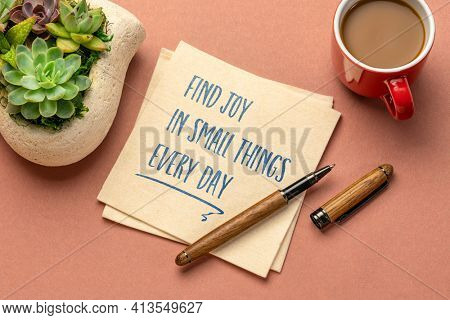 find joy in little things every day - inspirational handwriting on a napkin with a cup of coffee, positivity, mindset and personal development concept