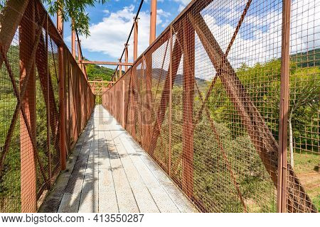 Iron Bridge With Mountains And Forest