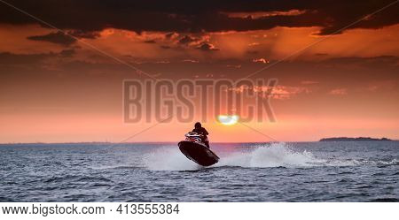 Russia, St.petersburg, 06 September 2020:the Person On A Hydrocycle In Flight Over Water On A Sunset
