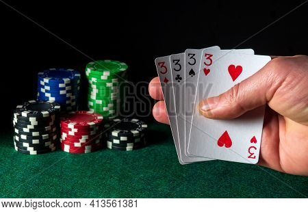 Poker Cards With Four Of A Kind Or Quads Combination. Close-up Of A Gambler Hand Is Holding Playing