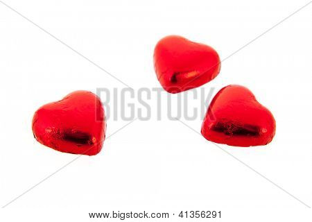 Red chocolate hearts isolated over white background