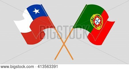Crossed And Waving Flags Of Chile And Portugal