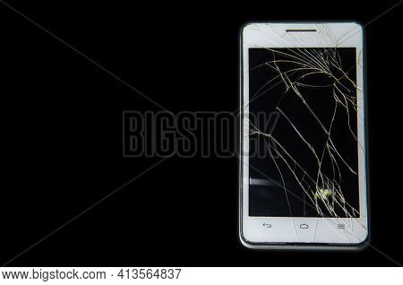Smartphone With A Broken Touch Screen. Mobile Phone Broken. The Phone Crashed. Replacing Broken Glas