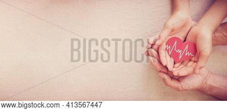 Hands Holding Red Heart With Cardiogram, Health Care, Life Insurance Business Concept, World Heart D